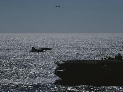 A Jet Comes in for a Landing on an Aircraft Carrier