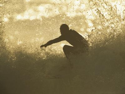 A Surfer Surrounded by the Spray of a Breaking Wave