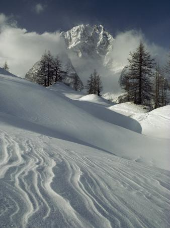 Mount Blanc Partially Obscured by Clouds in Snowy Landscape