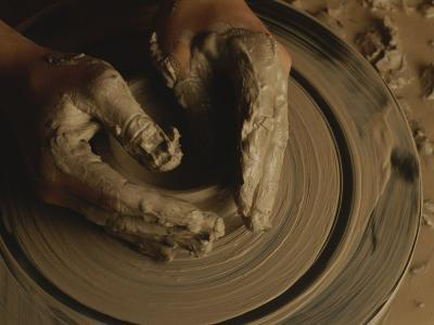 A Potter Makes a Pot from Clay