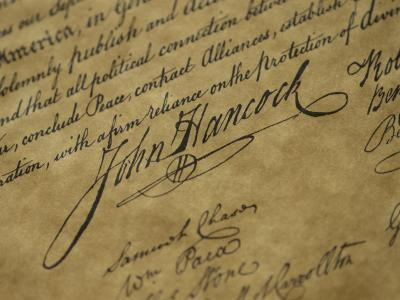 A Close View of John Hancocks Signature on a Reproduction of the Declaration of Independence