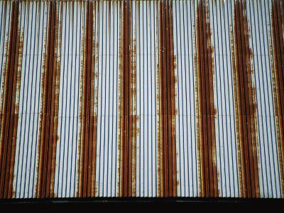 Lines of Rust Make a Bold Pattern Across an Old Corrugated Barn Roof