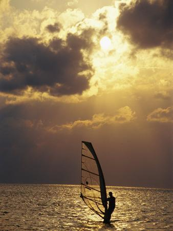 A Windsurfer Skims the Water, Silhouetted by Evening Sun on Pamlico Sound
