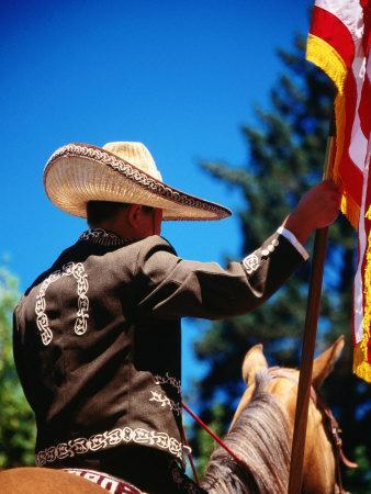 Man Riding a Horse in the Cinco De Mayo Parade for the Mexican Community, Calistoga, USA