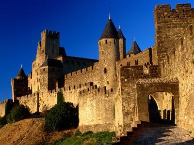 Tourists Enter Medieval Walled City at Sundown Via Porte D'Aude, Carcassonne, France
