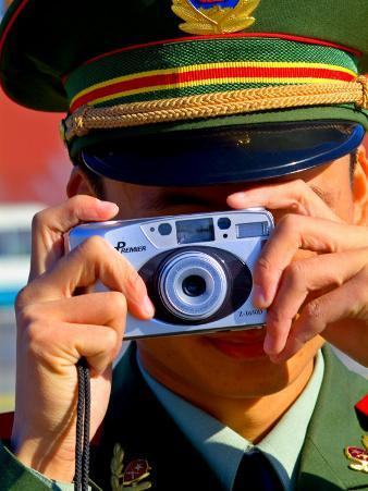 Guard Using His Camera on National Day in Tiananmen Square, Beijing, China