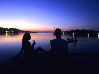 Silhouetted Couple at Dusk at Huntress Marina, Port Antonio, Jamaica