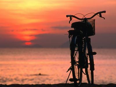 Bicycle Silhouetted Against Sunset on Nha Trang Beach, Nha Trang, Khanh Hoa, Vietnam