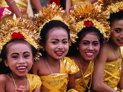 Smiling Faces on Four Young Girls All Dressed Up for a Temple Procession, Indonesia
