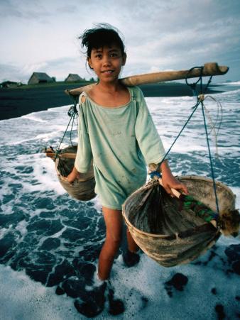 A Girl Gathers Salt Water in Lontar Leaf Buckets for Salt Making, Kusamba, Indonesia