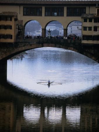 Rower on Arno River Passing Beneath Ponte Vecchio, Florence, Tuscany, Italy