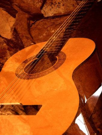 Double Exposure of Guitar and Rocks