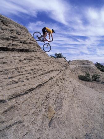 Active Male Rides Slickrock Ridge, Utah, USA