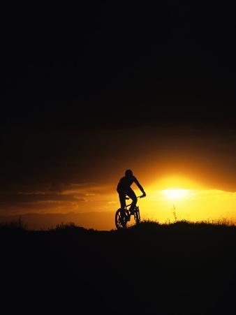 Mountain Biker Against Stormy Sunset, Fruita, Colorado, USA
