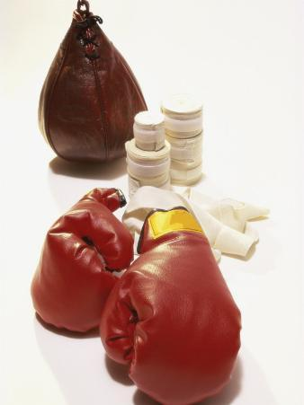 Pair of Boxing Gloves with a Punching Bag and Bandage Tape