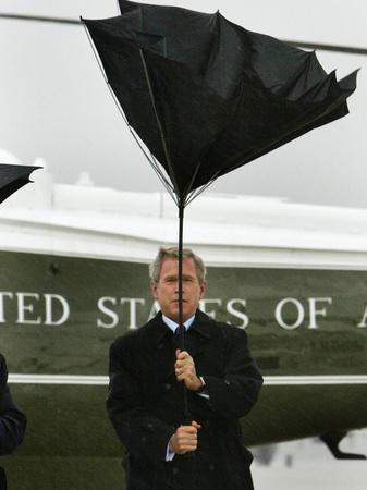 President Bush Jokingly Holds His Wind-Blown Umbrella Upright