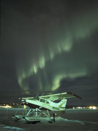 Northern Lights Illuminate a Snow-Covered Maule M-5, Fairbanks, Alaska, USA
