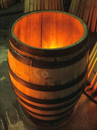 Toasting a New Oak Wine Barrel at the Demptos Cooperage, Napa Valley, California, USA
