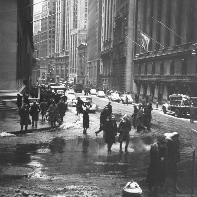 Pedestrians Crossing Slushy Intersection at Wall Street