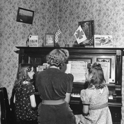 Patricia Colleen Altree Playing the Piano with Her Two Sisters