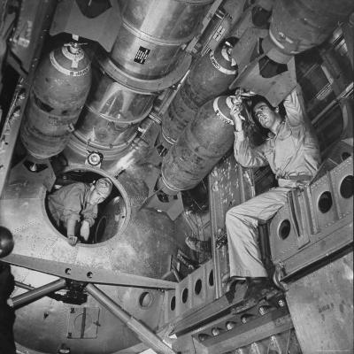 Ordnance Man Inserting Fuse Into 500 Lb. Demolition Bomb in Bomb Bay of B-29
