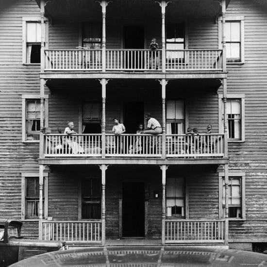 Help Me Find An Apartment: Family On Balcony Of Apartment Building Photographic Print