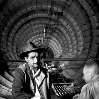 Millionaire Howard Hughes in Cockpit of Huge Sea Plane, Spruce Goose, Which He Designed and Built