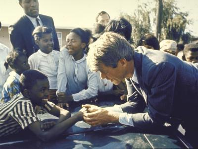 Presidential Contender Bobby Kennedy Stops During Campaigning to Shake Hands African American Boy