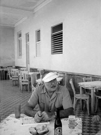 Author Ernest Hemingway in a Local Cafe