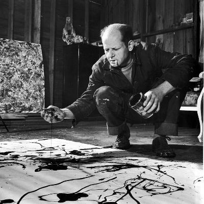 Painter Jackson Pollock Working in His Studio, Cigarette in Mouth, Dropping Paint Onto Canvas