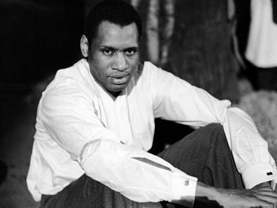 Singer and Actor Paul Robeson Sitting and Resting Arms on Knees. Circa 1940
