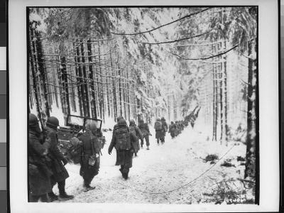 American soldiers on their tay to cut Off St. Vith Houffalize Road in Belgium, During WWII