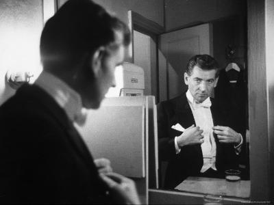 Composer/Conductor Leonard Bernstein Looking in Mirror before conducting Concert at Carnegie Hall