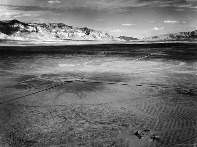 Aerial View of the First Atomic Bomb's Dark Scar Below Sierra Oscura Mountain in Desert