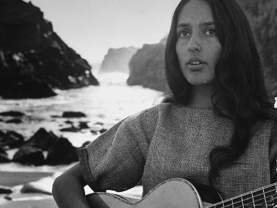 Folk Singer Joan Baez on the Beach with Guitar Near Her Home