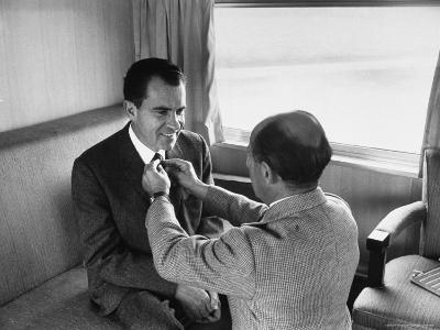 Life Photographer Alfred Eisenstaedt fix Presidential Candidate Richard Nixon's Tie During Campaign