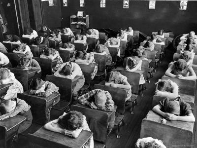 Elementary School Children with Heads Down on Desk During Rest Period in Classroom