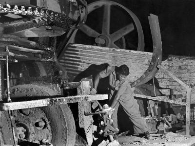 African American Worker Mrs. Rosalie Ivy Using Shovel to Mix a Special Mud Used to Seal the Hole