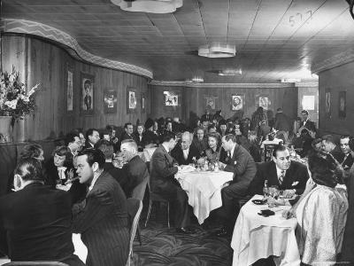 Actor Orson Welles at Table on Left with Cigar in His Mouth