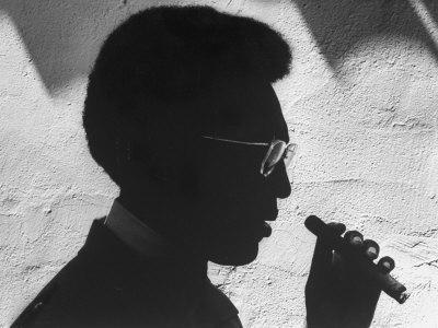 """Silhouette of Actor/Comedian Bill Cosby with Cigar, Former Star of TV Series """"I Spy"""""""