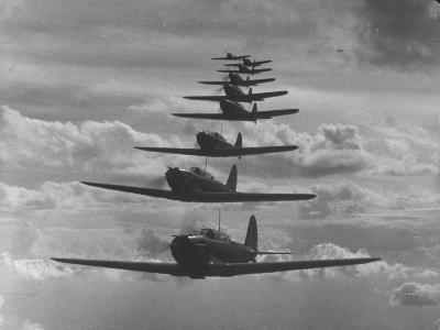 Nine Army Air Corps Bi-Place Pursuit Planes Flying in Formation with a Maximum Speed of 300 M.P.H