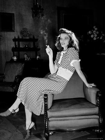 "Katharine Hepburn in chair Smoking Cigarette in Scene from Broadway Show ""The Philadelphia Story"""