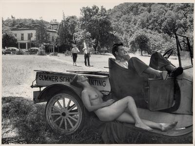 Nude Model Doris Fischer takes a break from posing for Students at Oxbow
