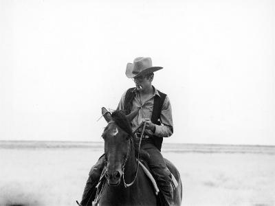 """Actor James Dean Clad in Western Garb for His Role, Riding Horse on Location for the Movie """"Giant"""""""