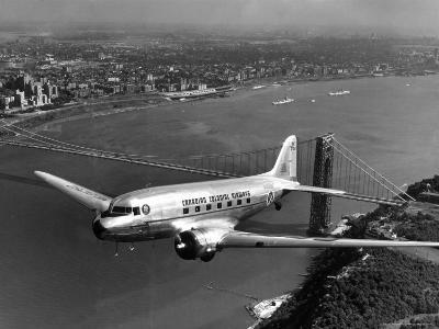 Canadian Colonial Airways Passenger Plane Flys over George Washington Bridge in Montreal, Canada