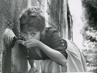 Actress Sophia Loren Drinking Water from Spigot During the Filming of Madame Sans Gene
