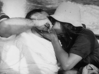 Film Producer Carlo Ponti and Wife, Actress Sophia Loren Kissing While on a Motorboat Ride