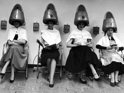 "Women Sitting and Reading under Hairdryers at Rockefeller Center ""Pamper Club"""