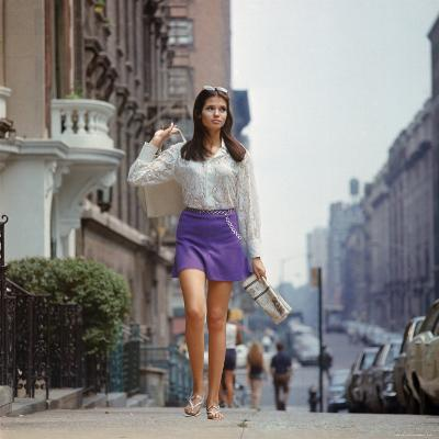 """Long Hair Woman with short skirt, lace top and sandals walking up street in """"New York Look"""" fashion"""