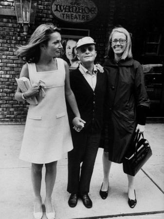 Lee Radziwill, Truman Capote, and Jane Howard Walking Arm in Arm While Leaving the Ivanhoe Theater